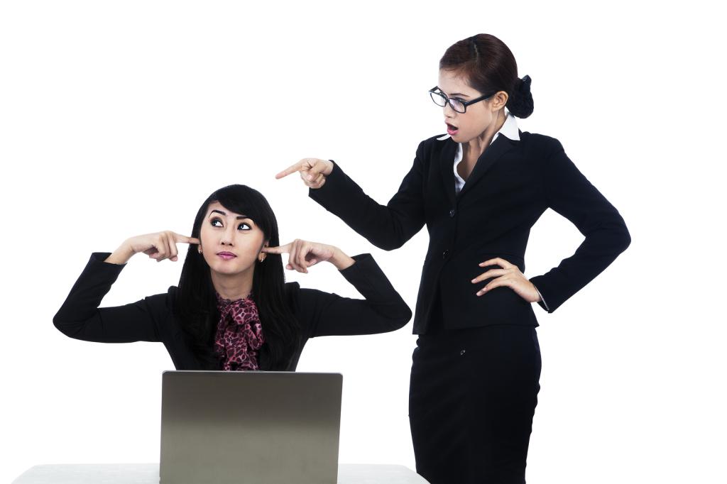Business Woman Yelling At Employee