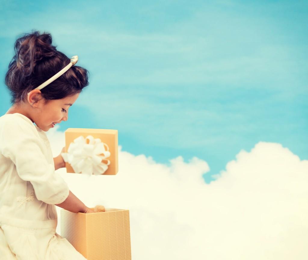 holidays, presents, christmas, birthday concept - happy child gi